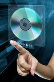 Woman hand on screen. A woman hand press eject dvd n on a digital screen Royalty Free Stock Photos