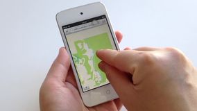Woman hand searching map with the index finger on smart device stock footage