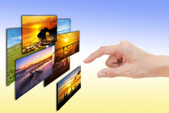 Woman hand select photo Stock Images