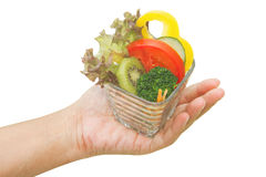 Woman hand serve vegetable salad cup Stock Photo
