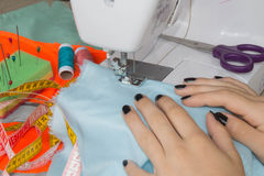 Woman hand on sewing machine.Dressmaker work on the sewing machine. Hobby sewing fabric as a small business concept Royalty Free Stock Photos