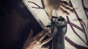 Woman hand sewing with vintage machine, top view Stock Image
