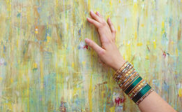 Woman hand with shiny colorful bracelets Stock Photography