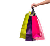 Woman hand with shopping bags on white background Royalty Free Stock Image
