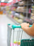 Woman hand with shopping cart Royalty Free Stock Image