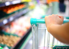 Woman hand with shopping cart Royalty Free Stock Photography