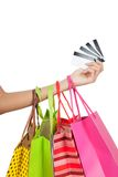 Woman hand show credit cards  with shopping bags Royalty Free Stock Image