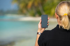 Woman hand showing a blank smart phone Stock Image