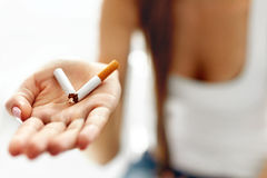Woman Hand Showing Broken Cigarette. Unhealthy Lifestyle Royalty Free Stock Photography