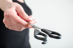 Woman hand showing a pair of scissors. Closeup royalty free stock photography