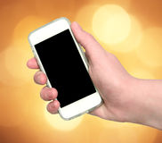 Woman hand showing smart phone with isolated screen on an abstra Royalty Free Stock Photo