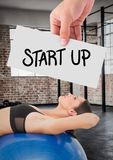 Woman hand showing start up card. In fitness studio Stock Image