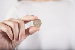 Woman hand showing worn Euro coin Royalty Free Stock Photos