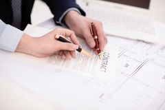 Woman hand signing a contract. In office Stock Photography