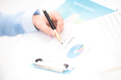 Woman hand signing a contract. In office Stock Image
