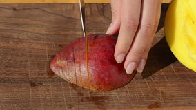 Woman hand slice ripe ecologic mango fruit knife wooden board stock footage
