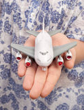 Woman hand with a small plane Stock Photos