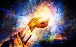 Woman hand with spiritual mystic light, painting collage. Cosmic space. Woman hand with spiritual mystic light, painting collage. Cosmic space Royalty Free Stock Photo