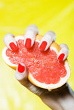 Woman Hand Squeezing a grapefruit Royalty Free Stock Image