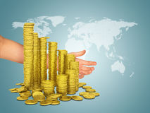 Woman hand and stack of gold dollars Stock Images