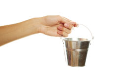 Woman hand with a steel pail Stock Photos