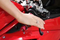 Woman hand on the steering wheel motorcycle Royalty Free Stock Photo
