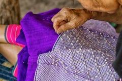 Woman hand stitching cloth Royalty Free Stock Photo