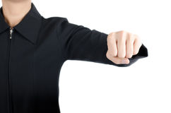Woman hand in suit punching on white background Stock Photos
