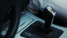 Woman hand switching gear stick in car. Driver. Transport. stock footage