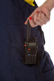 Woman hand take off cb radio from pocket Royalty Free Stock Photo