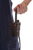 Woman hand take off cb radio from pocket Stock Photos