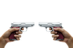 Woman hand taking gun waiting to shoot each other Stock Photos