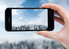 Woman hand taking photo of the city Stock Photography