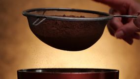 Woman hand tap strainer to sprinkle cocoa stock footage