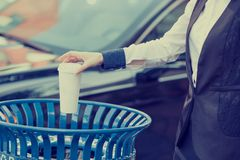 Woman hand throwing empty coffee cup in recycling bin Royalty Free Stock Photos