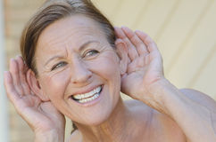 Woman hand to ear listening isolated outdoor III stock photo