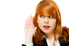 Woman with hand to ear listening. Woman surprised with hand to ear listening secret gossip or quiet sound. girl eavesdroping royalty free stock images
