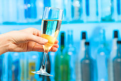 Woman hand toasting champagne in crystal glass Royalty Free Stock Photo