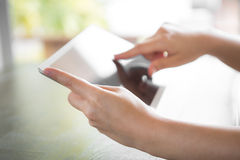 Woman hand touch white tablet Stock Photo