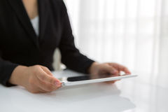 Woman hand touch white tablet Stock Images