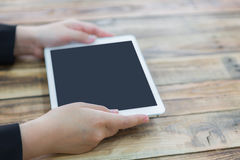 Woman hand touch white tablet Royalty Free Stock Photos