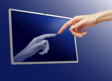 Woman hand touching computer monitor Stock Image