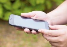 Woman hand touching screen on smart phone 2 Stock Photo