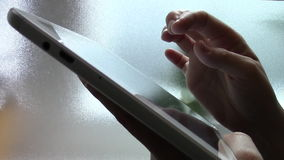 woman hand touching tablet computer surface touchscreen