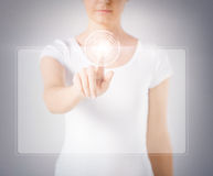 Woman hand touching virtual screen Royalty Free Stock Photo