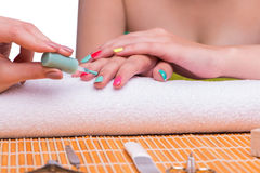 The woman in hand treatment manicure concept Stock Photography