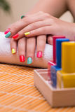 The woman in hand treatment manicure concept Stock Images