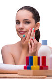 The woman in hand treatment manicure concept Stock Image
