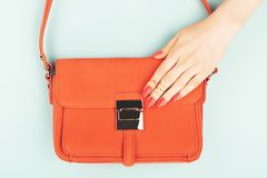 Woman hand on trendy fashion bag royalty free stock photo