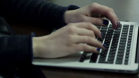 Woman hand typing on laptop keyboard stock footage